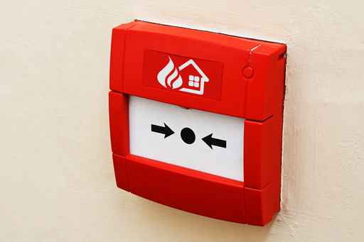 Fire alarm button on wall